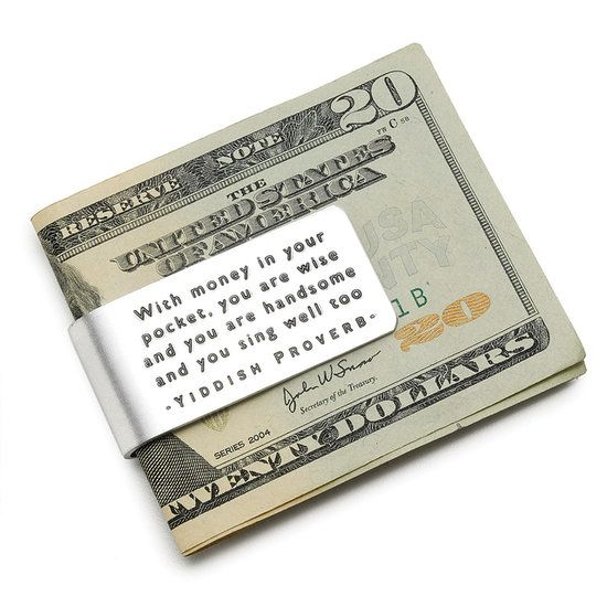 "Yiddish Proverb Money Clip: Get a chuckle or two with this Yiddish Proverb Money Clip ($18). It says, ""With money in your pocket, you are wise and you are handsome and you sing well too."""