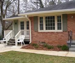 orange brick house with siding