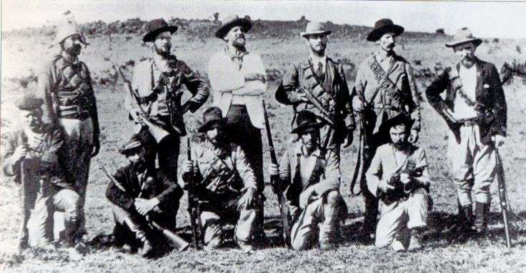 American volunteers who joined the Boers against the British Empire. Col. Arthur Alfred Lynch, commander of the Irish Brigade, stands in the centre of the back row, wearing a white jacket.