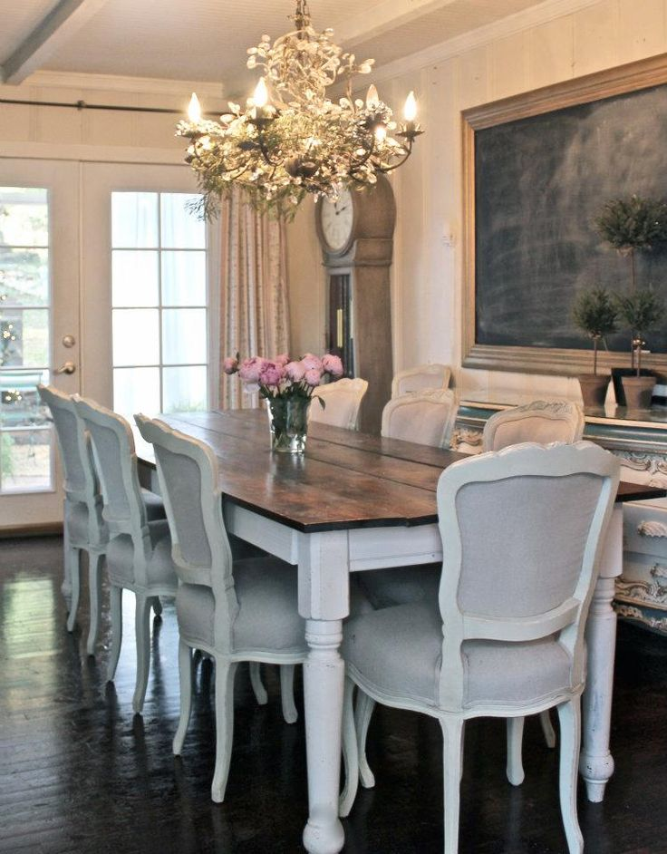 Table, chairs, chandelier, chalkboard. Beautiful dining room!