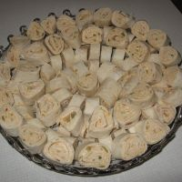 Mexican Cream Cheese Roll-ups...perfect snack food for Summer BBQ get together...personally I think sliced Black Olives would kick it up some too.