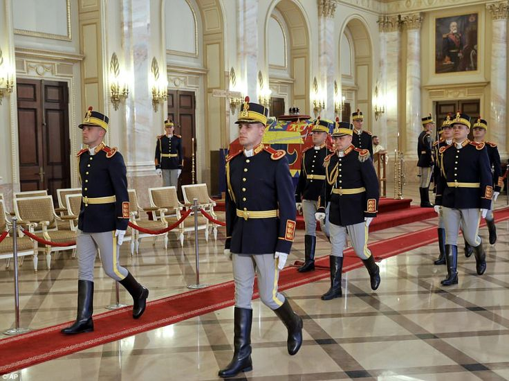 Honor guard soldiers perform a changing of the guard by the coffin of late Romanian King M...