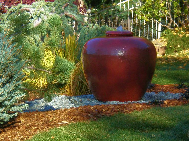 Water Feature Made Out Of An Oversized Ceramic Pot, With A Small Fountain  In The