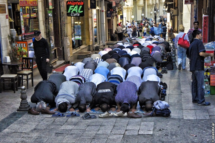 Praying on the streets. Police is closing Friday evening the streets for the holy pray.
