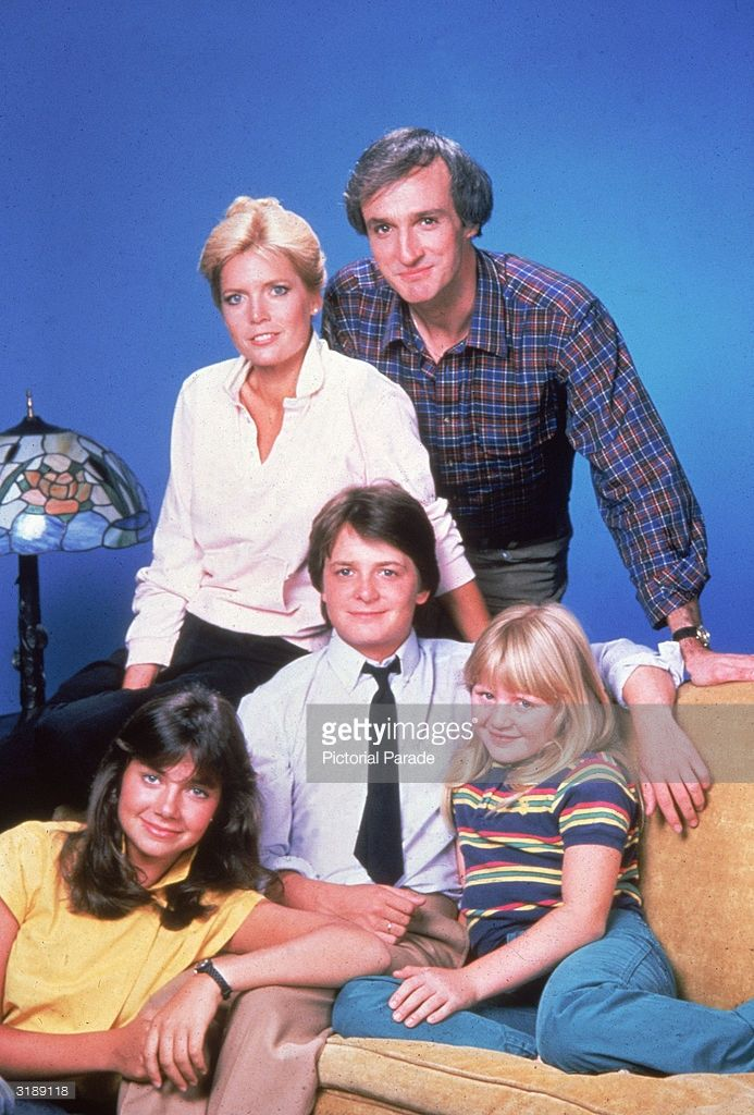 Promotional portrait of the cast of American television sit-com, 'Family Ties,' 1980s. Standing, American actors Meredith Baxter Birney and Michael Gross; sitting, left to right, American actress Justine Bateman, Canadian-born actor Michael J. Fox, and American actress Tina Yothers.