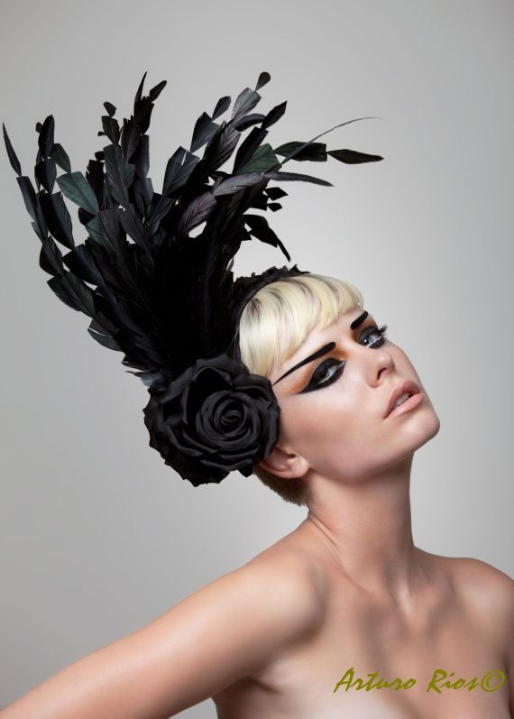 This Gorgeous headpiece is made on a 21/2 wide headband covered with a ruffle silk with black paillettes, adorned with 2 silk roses and long rooster feathers.  it also comes on white. all hats are made by request, please allow 5 days while we make and ship it. All sales are Final   if you have any question please feel free to contact me make sure to visit my store where you will find other gorgeous couture hats  PS.. please visit my Bridal Shop, you will find gorgeous headpieces just for…