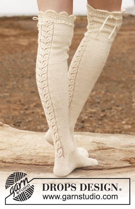 "Free pattern: Knitted DROPS stockings with lace pattern in ""Fabel"". ~ #DROPSDesign #Garnstudio this would be cute to do for kids leg warmers or for long gloves too!"