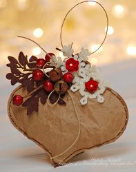 Brown Bag Christmas Ornament by Michele Kovack, favecrafts.com | Sizzix Big Shot/Embosser - Needle/thread - felt - lunch bag - Spellbinder's  ornament and snowflake dies - Glitter - Spray Adhesive - Jingle Bells: Westrim - Brown felt branch: Prima - Berry Sprig: Michaels - Red Posies: Doodlebug.  Read more at http://www.favecrafts.com/Ornaments/Simple-Brown-Bag-Christmas-Ornament/