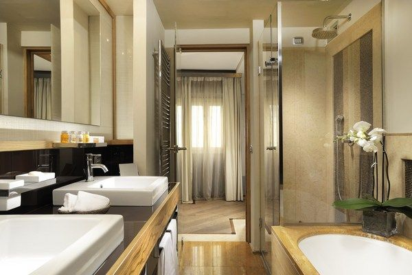 Mario de' Fiori 37 - Junior Suite: Every inch of the large, well-lit bathroom, with separate shower and roomy bathtub, is covered in handcrafted marble and mosaic. #RomeLuxury