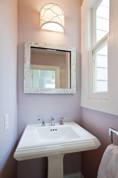 mother of pearl mosaic tile around mirror in a bathroom by melissa lenox design