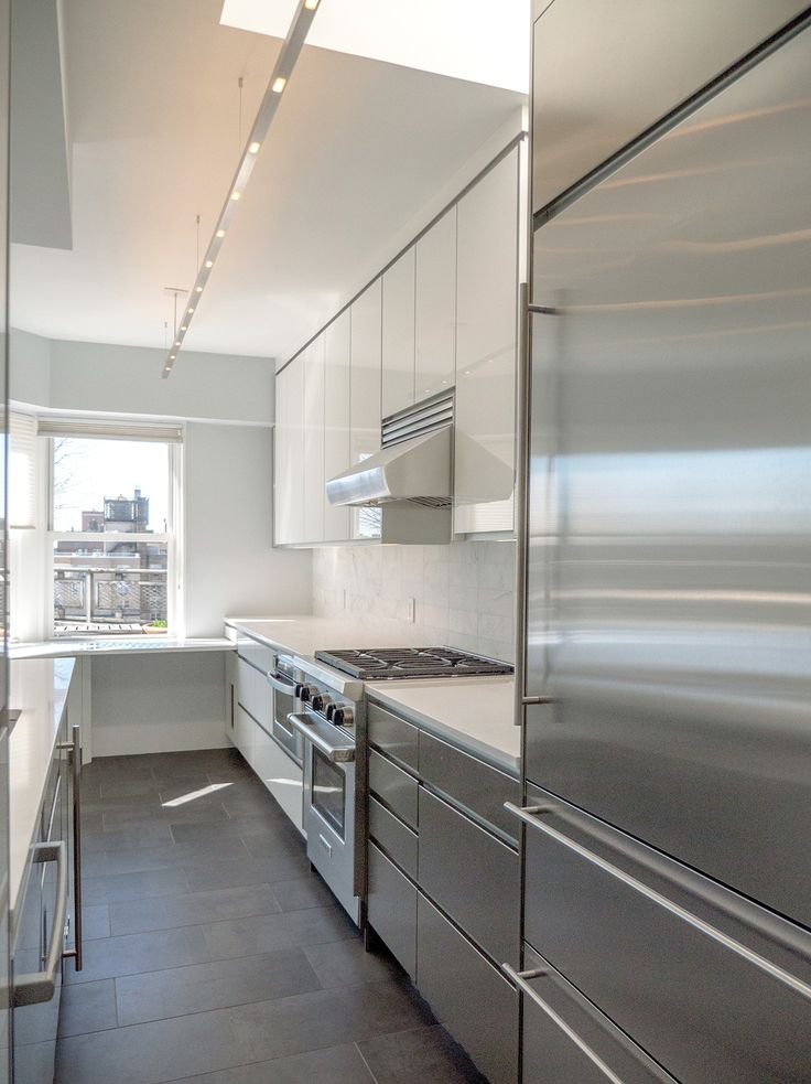 A modern, open kitchen is only as functional as its storage is plentiful! We strategically tucked custom cabinets and cubbies into every nook and cranny for this NYC kitchenrenovation.   Paula McDonald Design Build & Interiors
