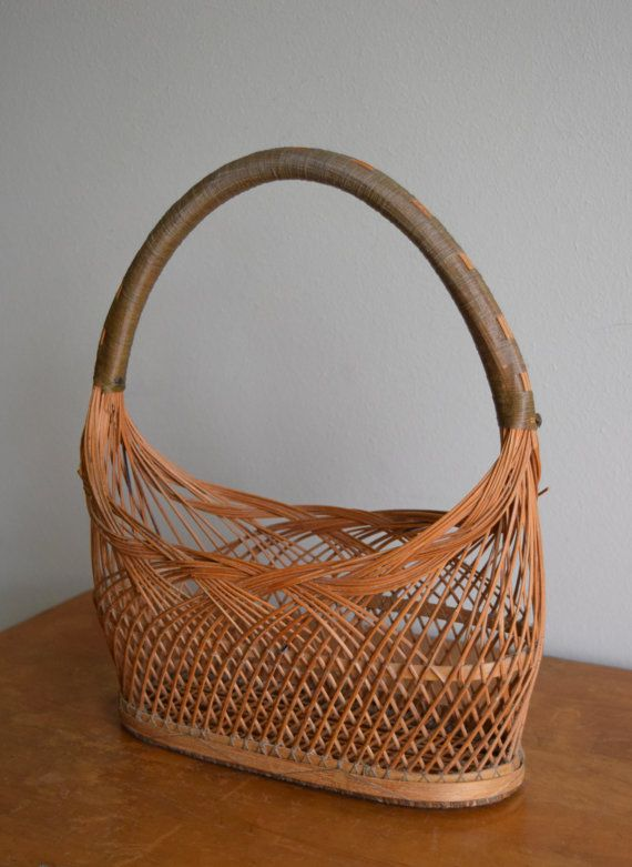 Unique vintage / antique handmade wicker basket! Handle and basket throughout is wrapped in fishing line. In overall, good vintage condition.
