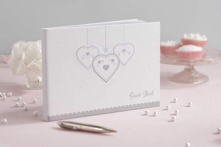 A stunning hard bound guest book with embossed heart design and 36 high quality blank pages. Capture your guests special messages and well wishes and keep them for years to come in this delightful book. The guest book comes in its own presentation box for safe keeping.