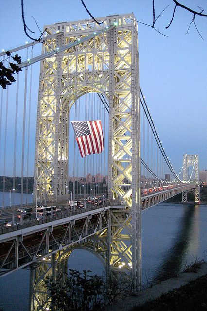 """The George Washington Bridge is a 4,760-foot bridge connecting upper Manhattan's Washington Heights to New Jersey. Completed and opened to traffic in October 1931, the suspension bridge towers 604 feet over the surface of the Hudson River below. It carries more than 106 million vehicles each year, making it the world's busiest motor vehicle bridge. In 1981, the bridge was designated as a National Historic Civil Engineering Landmark."""