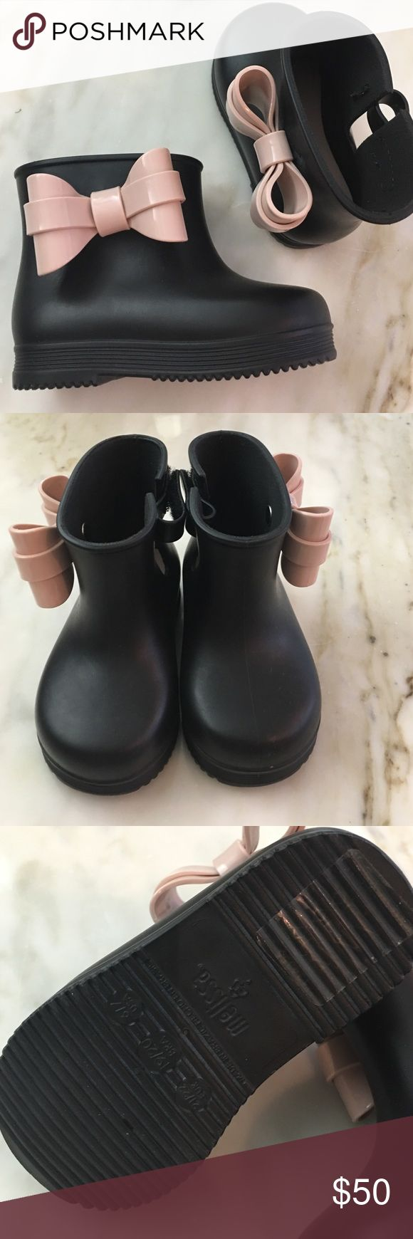 Toddler Mini Melissa boots Brand new black Mini Melissa boots with pink bows. Size 6/7. Never worn. This brand runs small. Adorable!!!!!!!! My baby outgrew before she could wear them. Selling at Saks right now for $65. Mini Melissa Shoes Boots