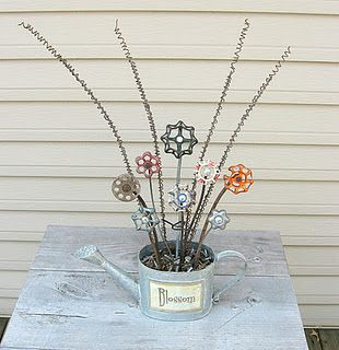 I am always looking for quirky things to put in the garden and I like these... I am sure I can find some faucet handle to repurpose