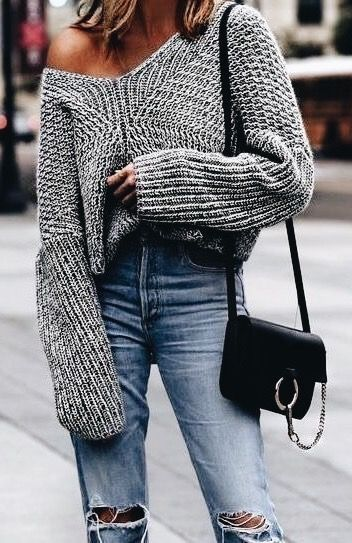 Gray oversized knit sweater with blue jeans.