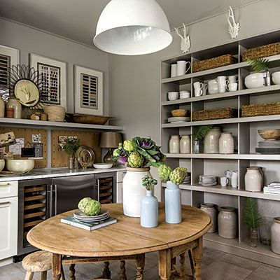 Side Rooms: The Clutter Room | This multipurpose room, located between the mudroom and the kitchen, houses a dishwasher, a sink, two walls of lower cabinets, and a full wall of open shelves to help with kitchen storage.