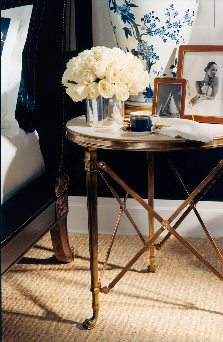 Gold bedside table, sisal rug, blue & white ginger jar lamp