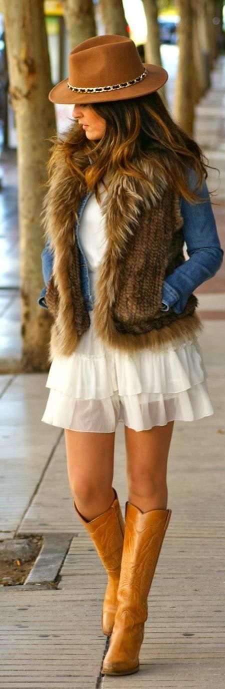 Modern hippie blue jean jacket and boho chic fur vest over gypsy style ruffled mini skirt with tall yellow cowboy boots. For the BEST Bohemian fashion style ideas FOLLOW http://www.pinterest.com/happygolicky/the-best-boho-chic-fashion-bohemian-jewelry-gypsy-/ now.