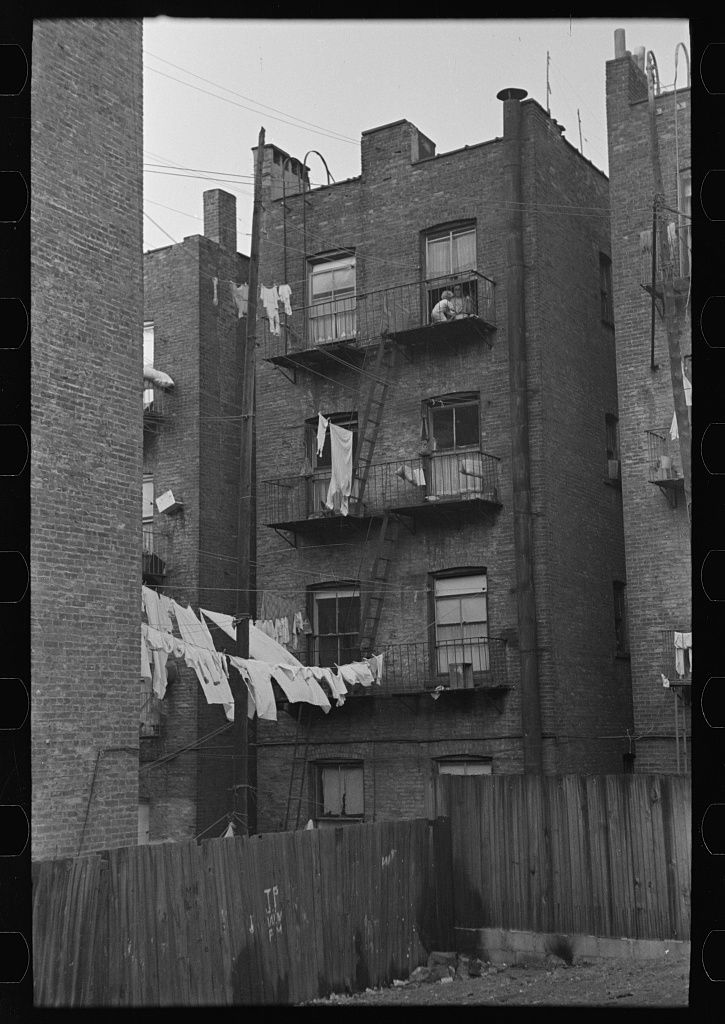 Apartment houses as viewed through vacant lot. In the vicinity of 139th street just east of St. Anne's Avenue, Bronx, New York. 1936 Nov. Library of Congress.
