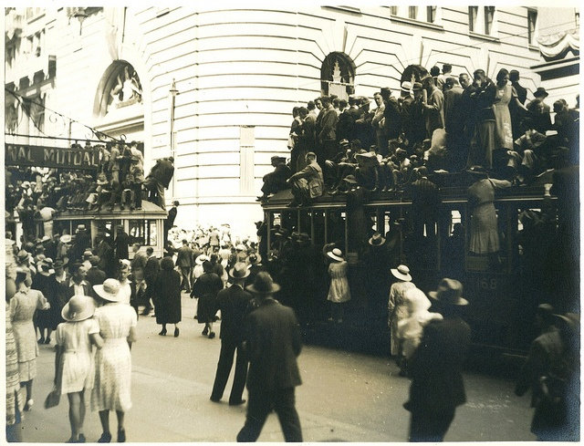 "Image 6. ""Australia Day 1938"" - Spectators of the Australian Sesquicentenary parade stand on trams for a better view, George Street, Sydney, 26 January 1938 / photographer Donald Charles Boulton Maclurcan by State Library of New South Wales collection, via Flickr"