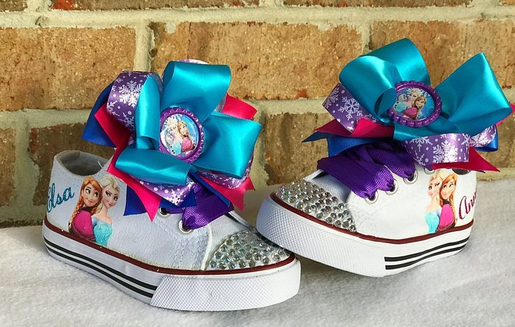 Complete your Frozen Birthday Outfit with these adorable Bling Sneakers! Decorated with crystal rhinestones on the toes and a vinyl image of Anna and Elsa on th