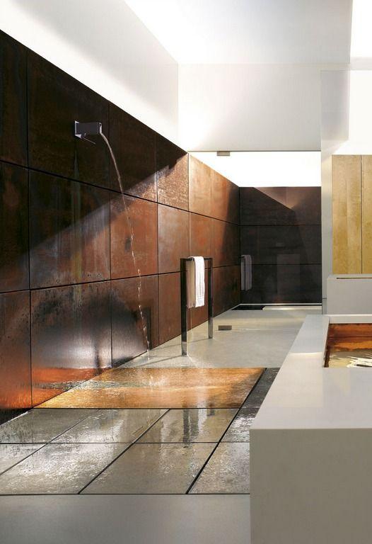 Conceptual bathroom with corten steel wall.
