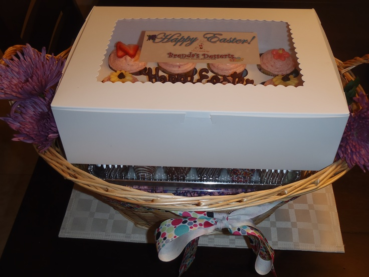 basket for Easter includes choc covered strawberries and cupcakes