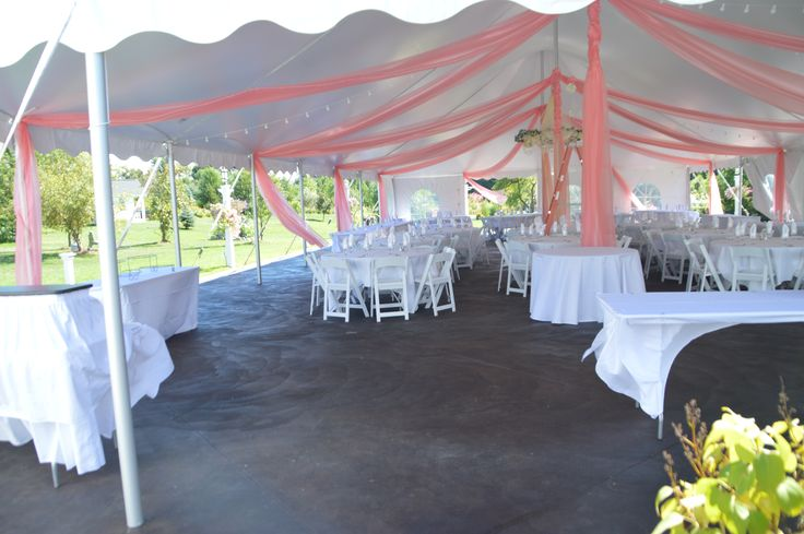 coral tent draping in a 40' x 80' white event tent on patio in the gardens at Apple Blossom Chapel and Gardens