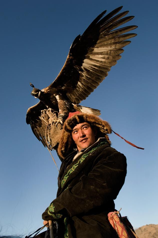 Qazaq Nomad- Mongolia. Qazaq people living in Mongolia near Bayan-Olgii use golden eagles to hunt wild sheep, foxes and wolves, and get together once a year in October to show off and compete.