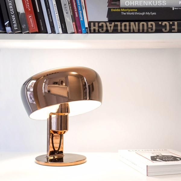 The chic metallic finishes of the ceramic Coppola table lamp make this Formagenda design a must-have item. In a choice of copper, gold, or platinum finish, the design is also highly functional,