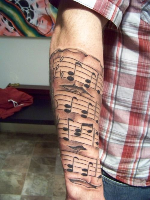 I want a half sleeve on my upper arm similar to this (a staff with music). I need to think of a song though.