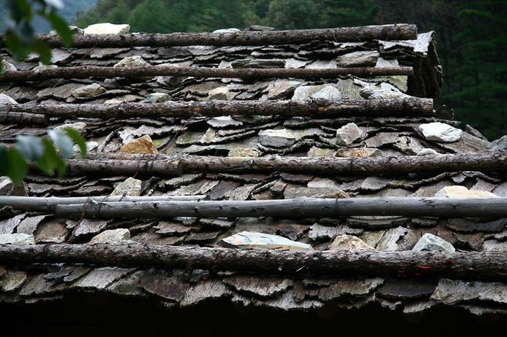 Birchwood bark, used for shingles, rocks and branches wired together to hold things down. Interesting little roof. Source unknown. Please feel free to share our content. And if you have any Questions, Ask us at http://askaroofer.com/ #AskARoofer #RoofingBlog #Roofing