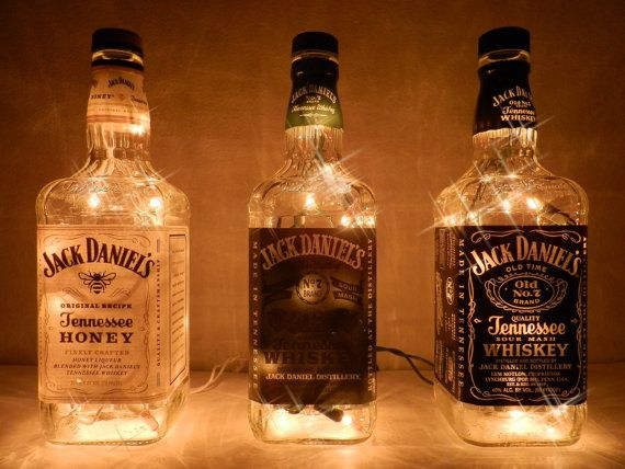 Repurposed Jack Daneils lighted bottles.  Three 750ml. bottles.  - Jack Honey - amber lights on white wire  - Jack Green Label - amber lights on green