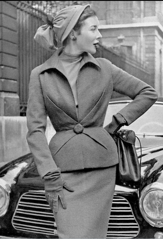 1951Bettina in suit with fitted jacket fastened by single button worn over jersey blouse by Schiaparelli, photo by Pottier,
