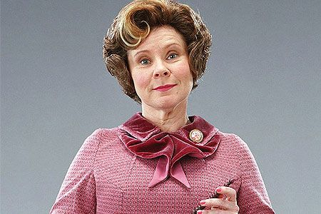 This woman is truly evil.  Last night, reading how she banned Harry from Quidditch, I wished Hermione would curse her good