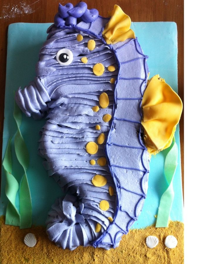 A pastel seahorse cake for a little girls first birthday
