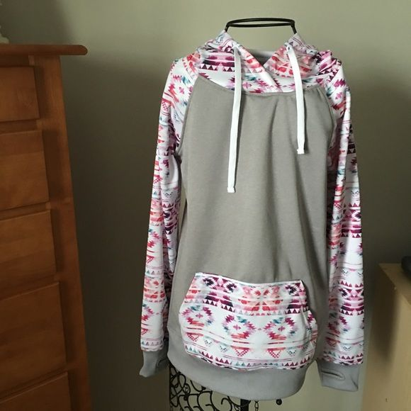"larissa tribal hoodie New. Never worn. Beautiful pattern. Warm. Good quality. Thumb holes on sleeves. ❌no trades or Paypal Quick shipping Offers welcome through ""Make an Offer"" feature. Empyre Tops Sweatshirts & Hoodies"