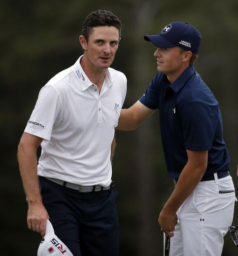 Jordan Spieth, right, speaks to Justin Rose, of England, after winning the Masters golf tournament S... - (AP Photo/Chris Carlson