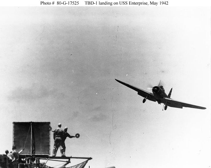 Douglas TBD-1 Devastator torpedo plane, of Torpedo Squadron Six (VT-6), approaches USS Enterprise (CV-6) to land, 4 May 1942. Note Landing Signal Officer at left.  Official U.S. Navy Photograph, now in the collections of the National Archives (#80-G-17525)