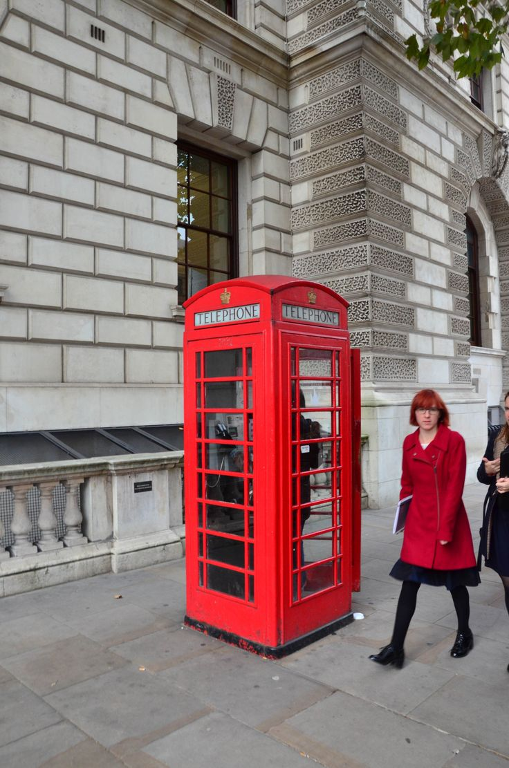 Classic red telephone box + funny suited woman - London [England Trip]
