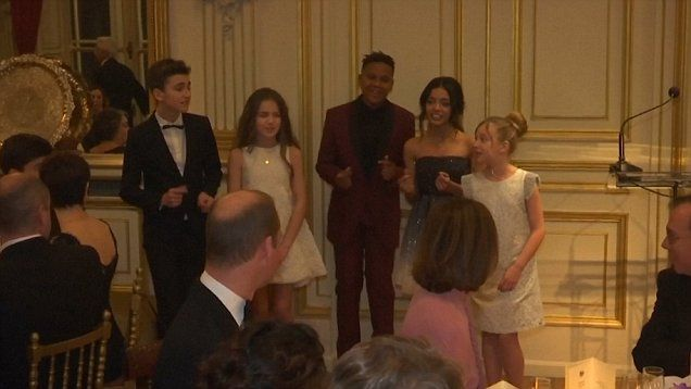 French choir sing Pharrell's 'Happy' to Prince William at a dinner he attended with Kate and other dignitaries.