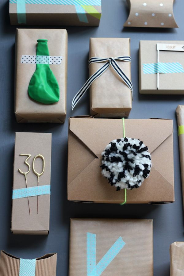 Adorable wrapping: use birthday balloons, sparklers, candles to decorate wrapped presents.