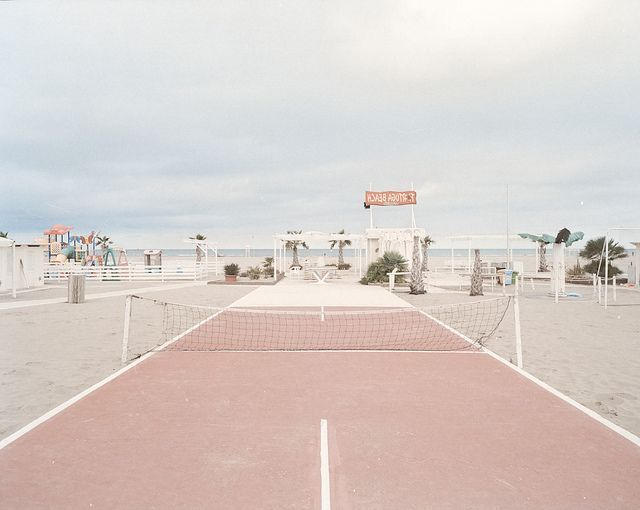 Pink tennis court on the beach.