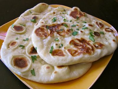 """iliar with naan, it is basically just an Indian style flat bread. Okay, maybe it's not """"just"""" flat bread. This stuff is AMAZING. It is soft, pillowy, full of lovely bubbles and so extremely versatile. You can eat this along side of a meal to sop up gravies and juices, you can make flat bread sandwiches with it, to"""