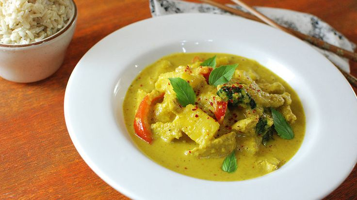 A Thai yellow curry recipe for chicken, jazzed up with pineapple and basil.