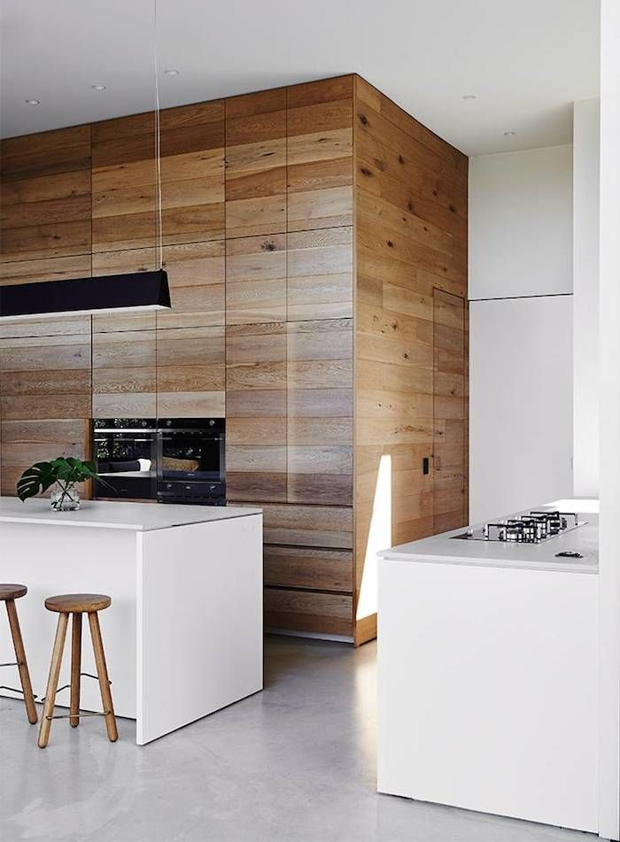 wood clad kitchen, mixed with white cabinets on island. Potential to hide office area within clad area.