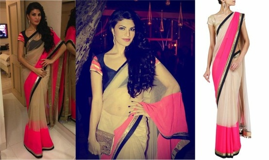 GET THIS LOOK: Jacqueline Fernandez in nude net Sari with neon pink chiffon and navy blue raw silk and gold embroidered border by Manish Malhotra  She looks gorgeous.  Shop at: https://www.perniaspopupshop.com/designers-1/manish-malhotra/manish-malhotra-11 — with Apurva Sarin.