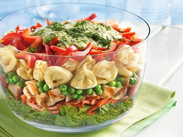 "Layered Tortellini Pesto Chicken Salad  I'm so ""chickened out"", I think I'll try bacon instead."